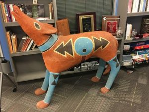 Modern wolf sculpture painted with Aztec design in terra cotta, turquoise and black